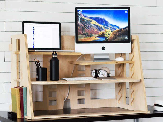 The Perch desk is desktop-mounted, allowing users to raise or lower their work equipment on separate platforms when standing or sitting