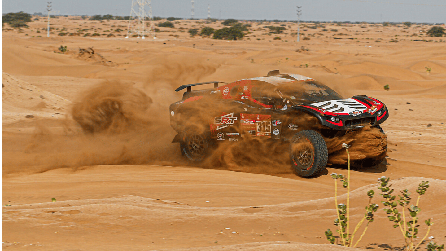 Sand whirls and dances around the SRT Racing car of Mathieu Sarradori and Fabian Lurquin