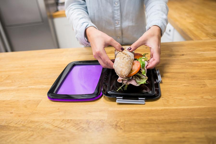 Unikia's FoodSkin lunch box folds flat when open
