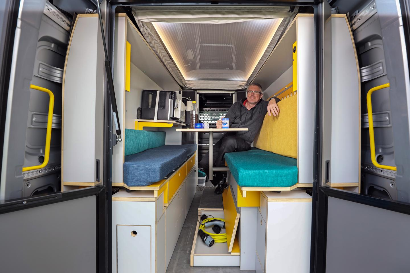 The versatile PlugVan interior adjusts from lounge, to dining room, to bedroom, to workstation, to kitchen, to breakfast in bed, to ...
