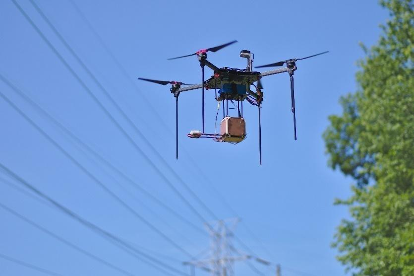 A quadcopter drone with a prototype version of the system