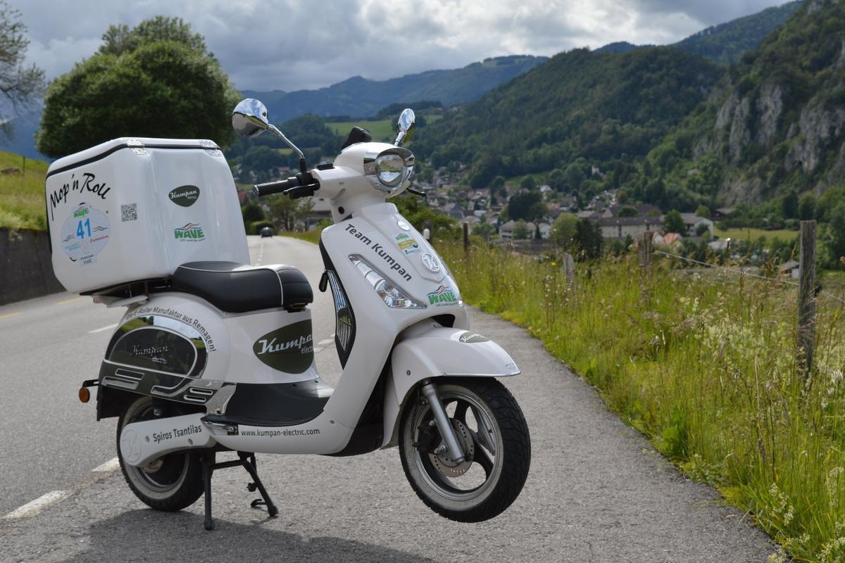 The Kumpan Electric 1954L posesin the Swiss Alps