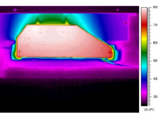 Infra-red image of an optimized EHD-cooled laptop after three minutesImage credit: Tessera