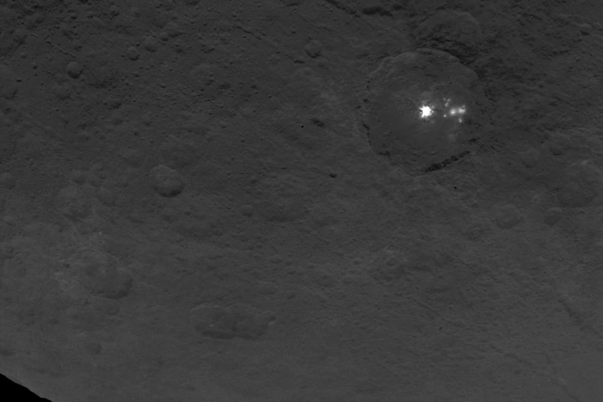 Eight smaller white spots are visible next to the primary spot in this image shot from Dawn on June 9