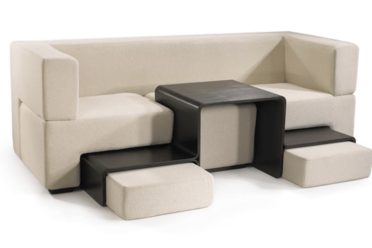 The Slot Sofa converts from two-seater to three-seater with coffee table and dual foot rests