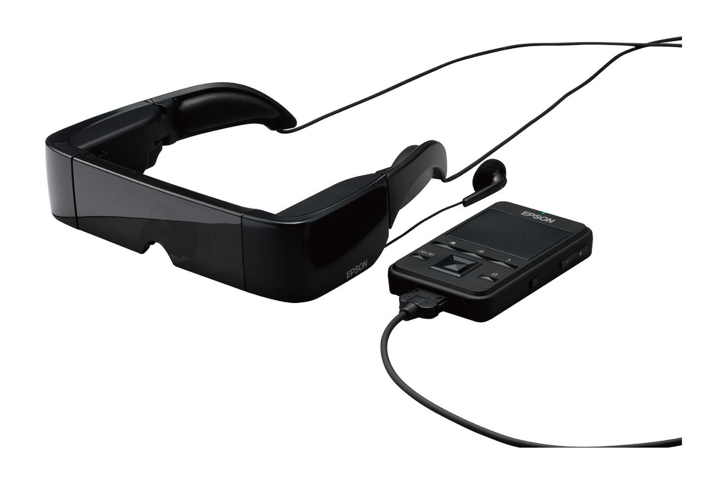 A thin cable connects a smartphone-sized, touch-enabled trackpad controller powered by Android 2.2 to the head gear