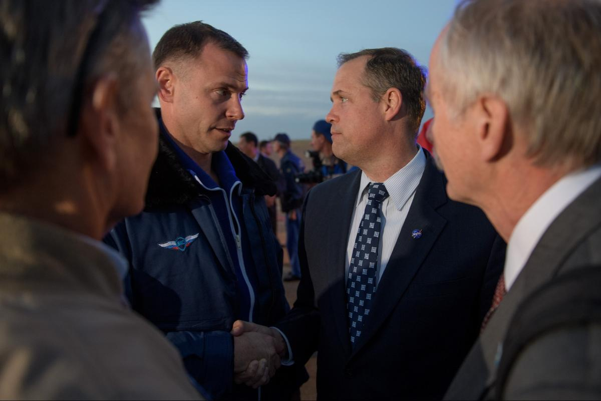 Expedition 57 Flight Engineer Nick Hague of NASA, left, is welcomed by NASA Administrator Jim Bridenstine after Hague landed at the Krayniy Airport