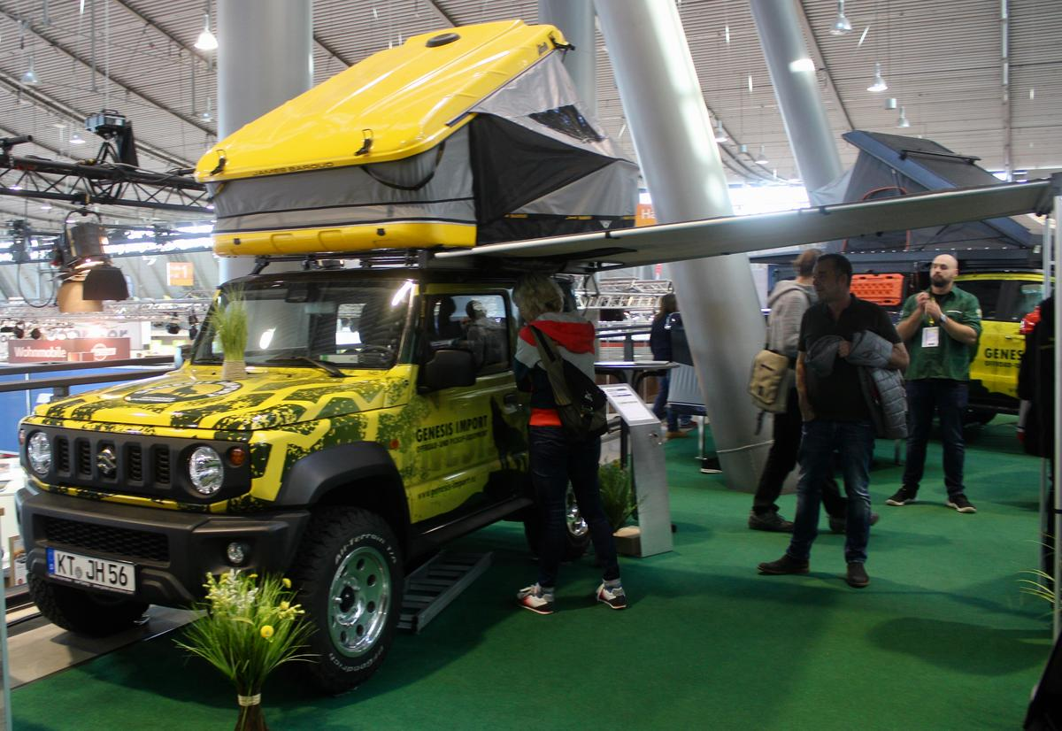 Our favorite overland rig of the show, a Suzuki Jimney with a hardshell roof-top tent and awning, on show at the booth of Genesis Imports
