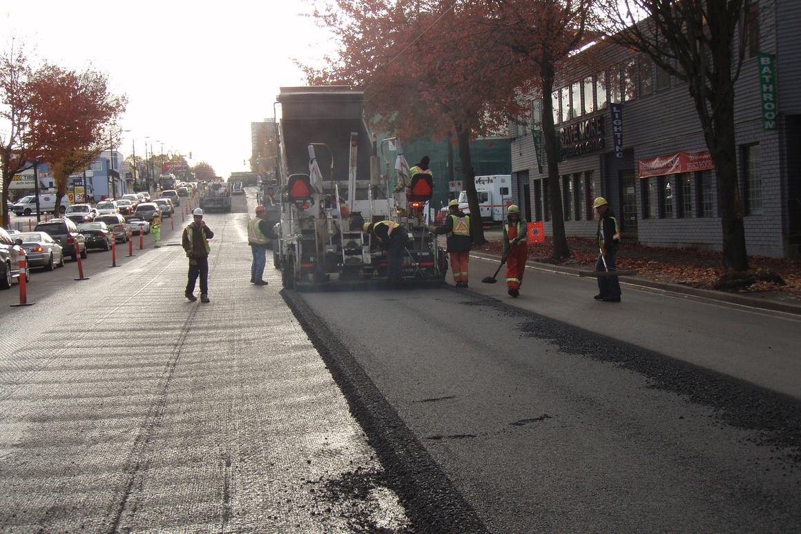 The warm mix truck laying the new asphalt mix at one of the trial locations in Vancouver