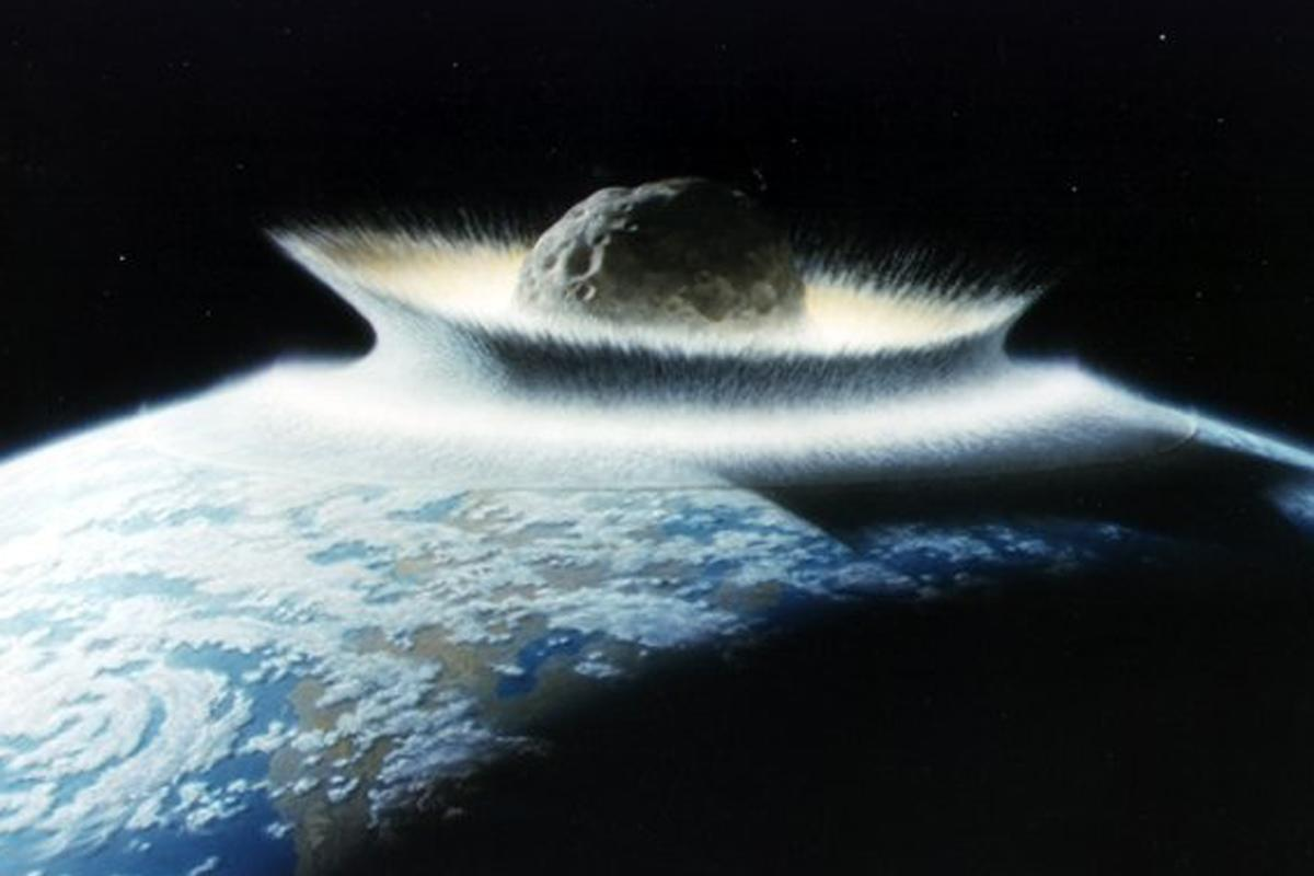 Artist's impression of a massive asteroid striking Earth (Image: NASA/Don Davis)