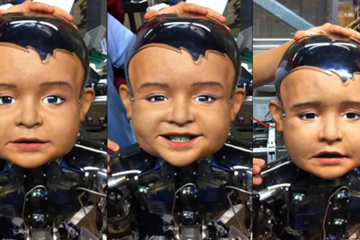 Diego-san, an expressive infant robot developed for UCSD's Machine Perception Lab, makes faces for the camera