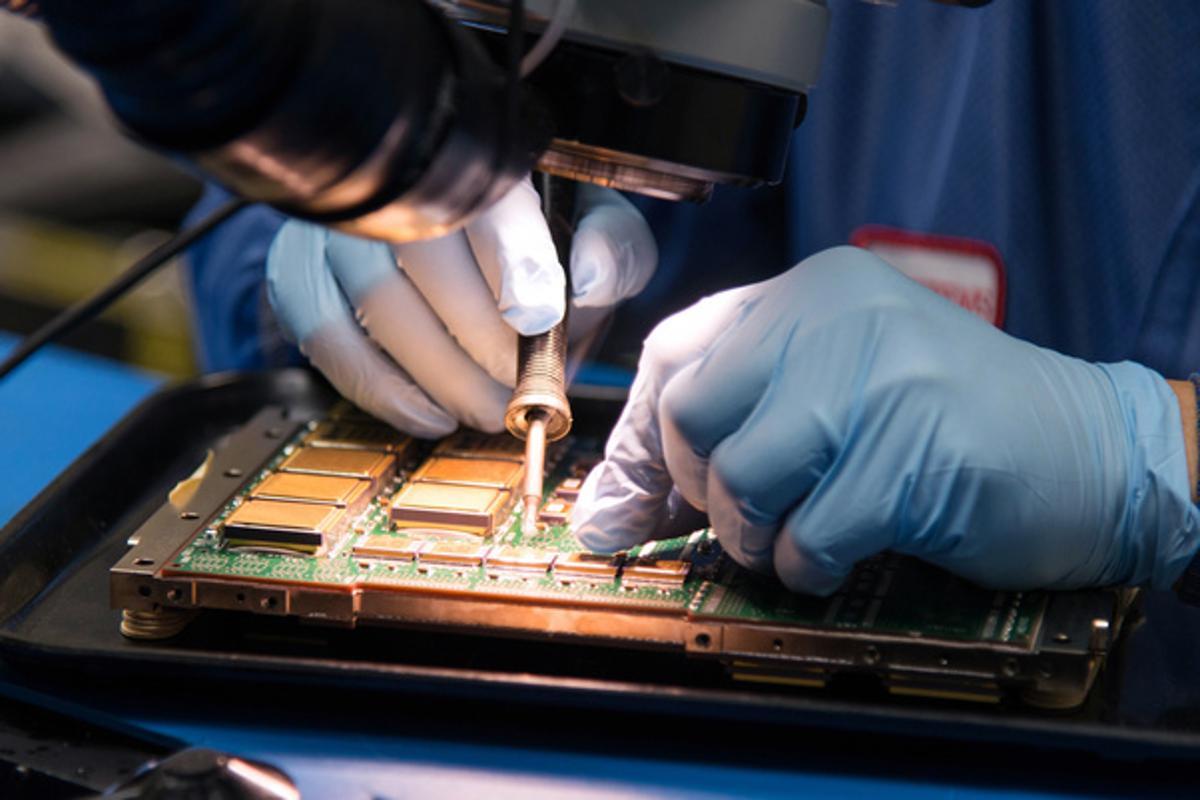 A technician soldering components in aRAD5545single-board computer
