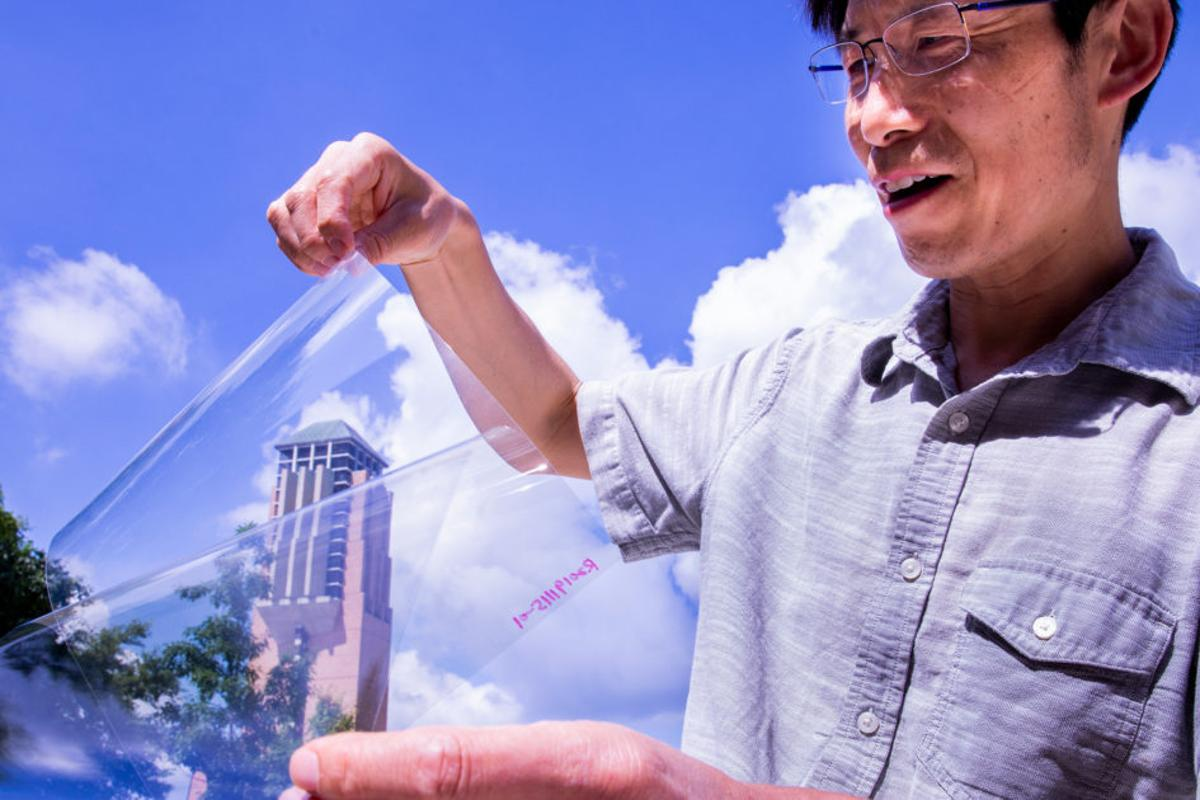 Lead researcher Jay Guo with the transparent, conductive plastic