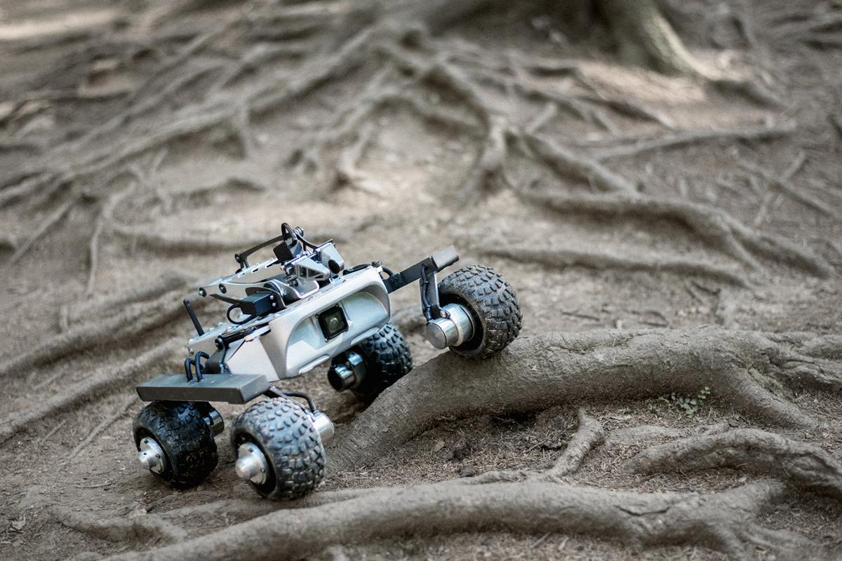 The Turtle Rover uses its NASA-inspired suspension to take on some roots