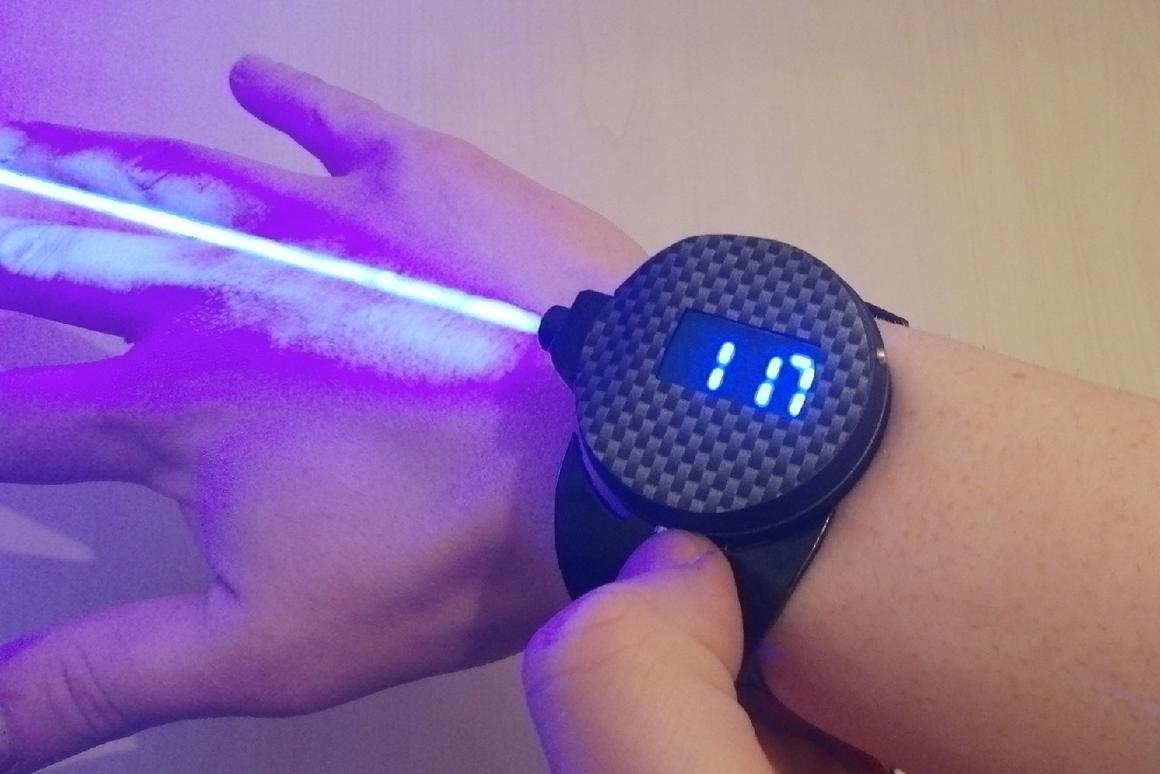 The LaserWatch displaying the time ... and doing that other thing