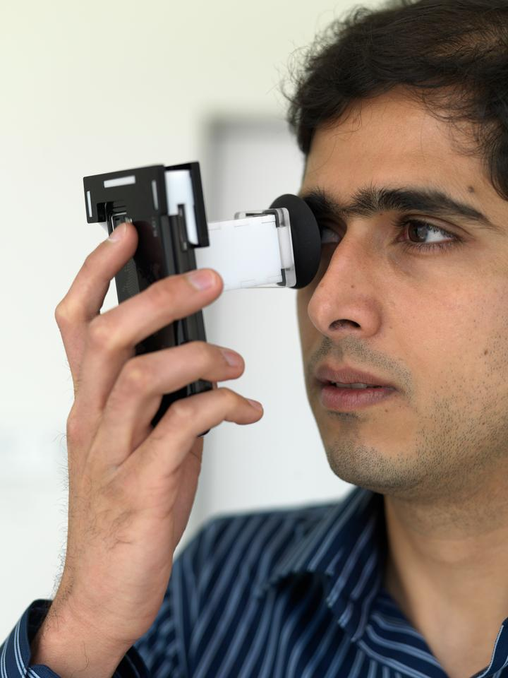 NETRA offers a simple, quick and inexpensive way to use mobile phones to measure refractive errors of the eye (Photo Credit, Andy Ryan)