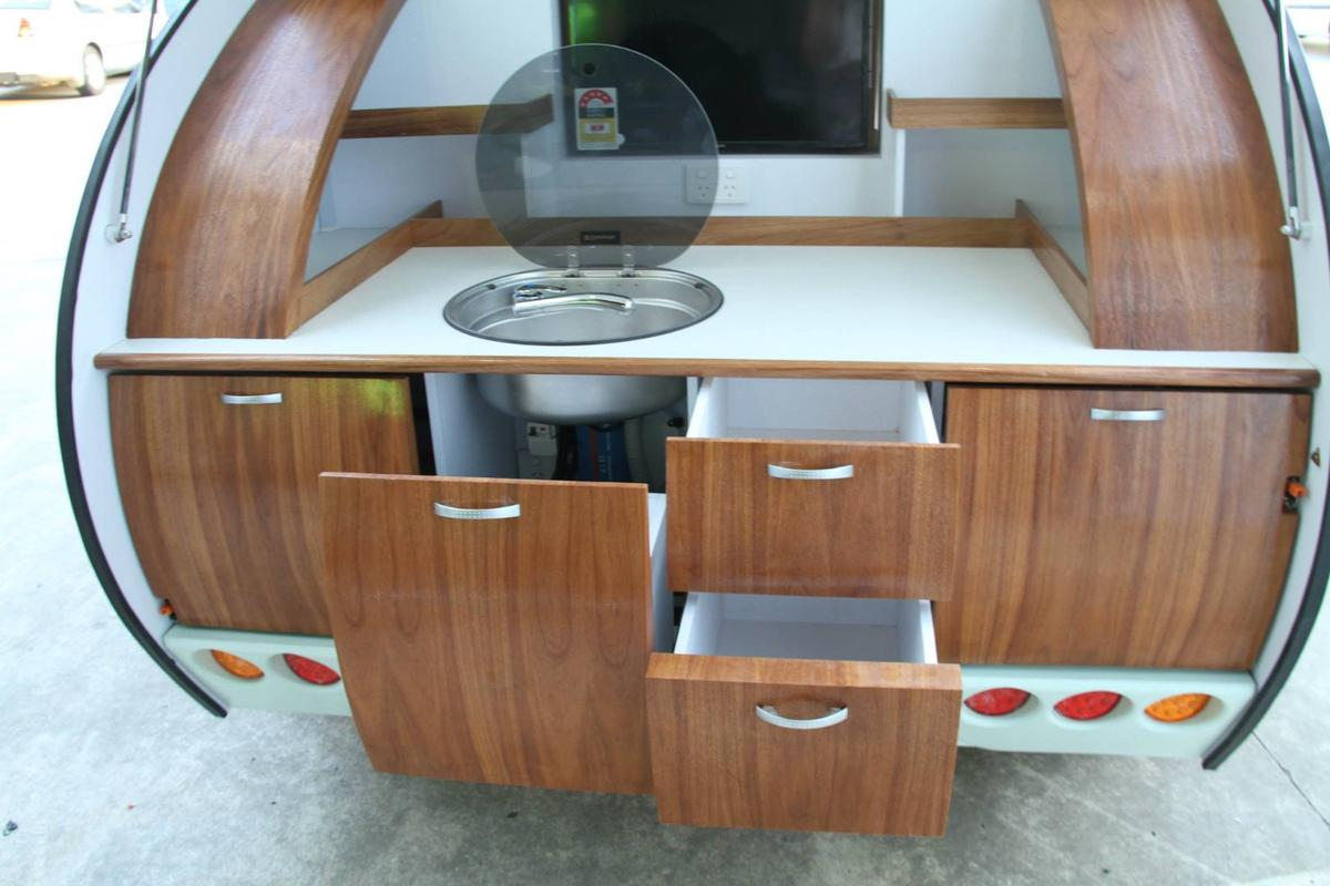 The Gidget trailers come with a galley with sink, refrigerator and cooktop