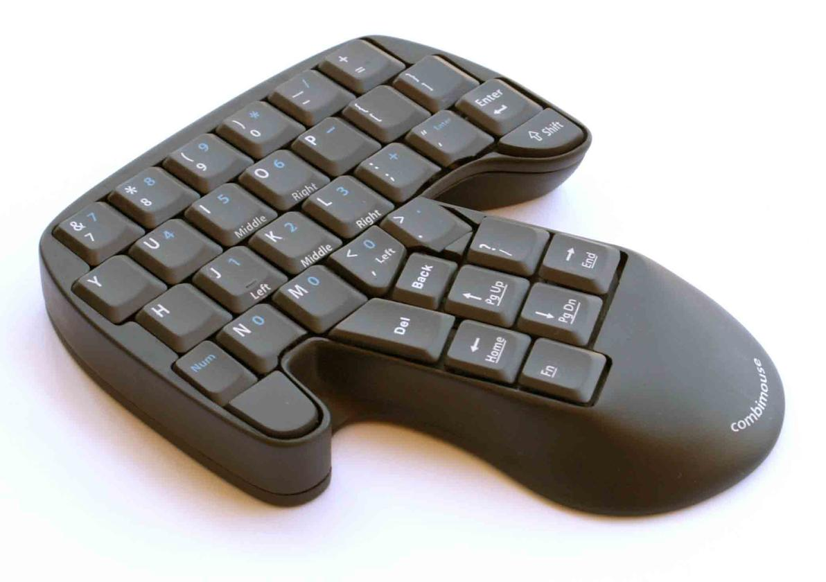 The rather odd-shaped keyboard/mouse combination has specific keys assigned two or three click button behavior when in mouse mode