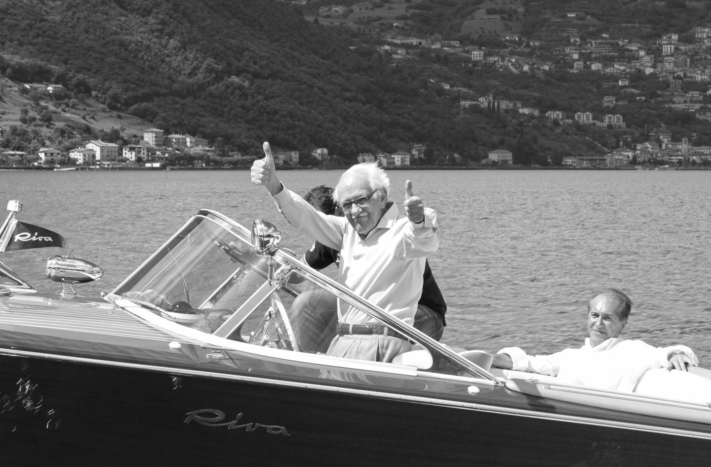 Carlo Riva rides in the restored Riva Aquarama