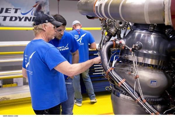 Aerojet Rocketdyne technicians inspect the first AR-22 rocket engine at the Aerojet Rocketdyne facility located at Stennis Space Center