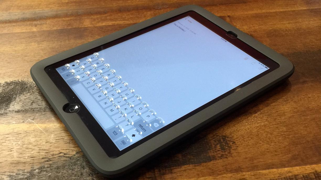 Activating Phorm causes physical buttons to appear over the characters on an iPad mini's virtual keyboard
