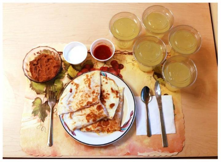 This image shows one of the study's processed lunches, consisting of quesadillas, refried beans, and diet lemonade