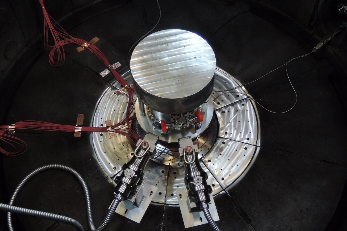 Two fast neutron radiation-effects cassettes aim toward the center of the containment system for tritium within the Z vacuum chamber at Sandia National Laboratories