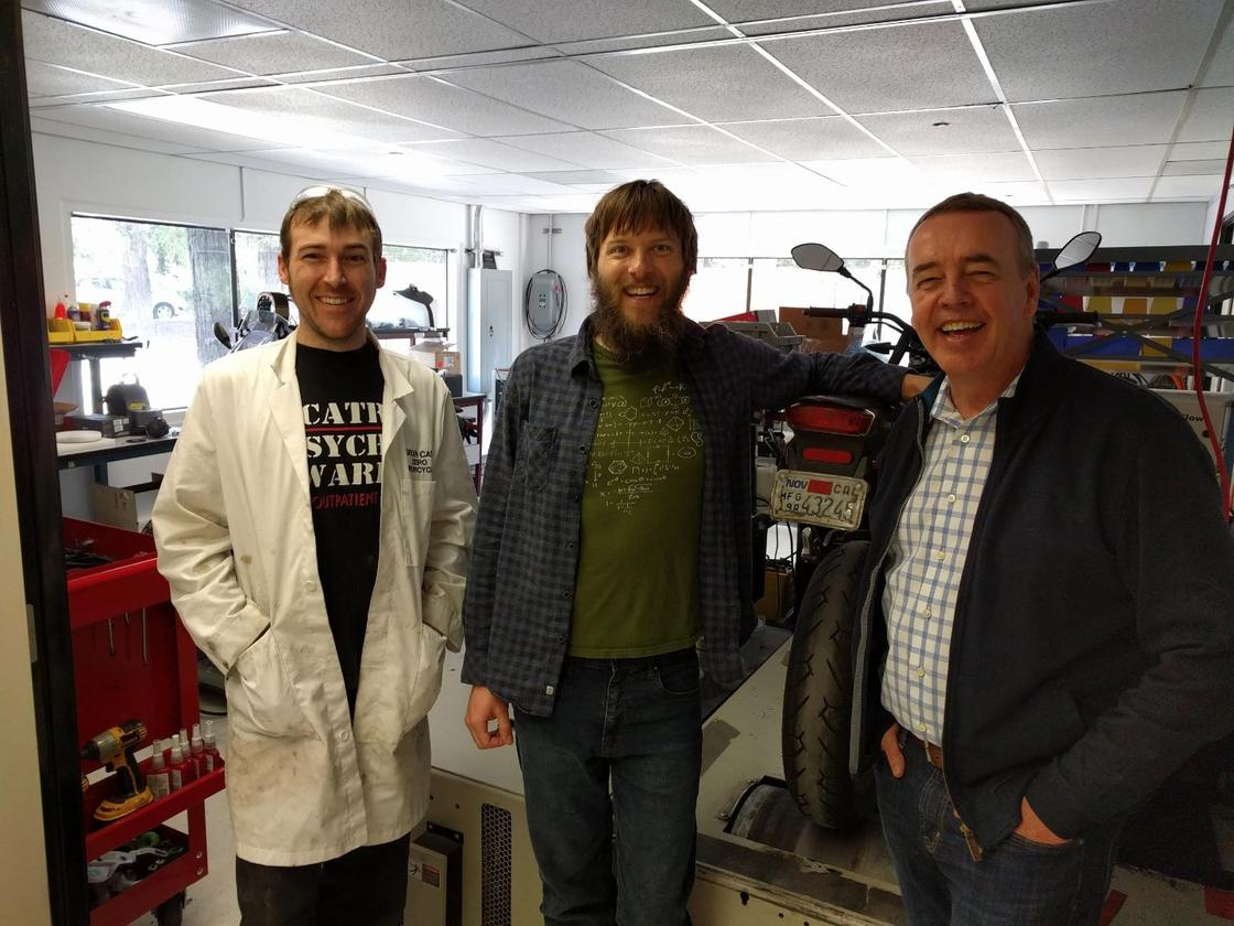 """Luke Workman (centre) with Zero Motorcycles CEO Richard Walker (right) and Bryan Cady (left) - """"Bryan Cady is Zero's R&D wizard of everything from polymer engineering to radar system design. His official title is something like R&D test engineer, but if it doesn't mention wizard or epic super-genius it seems less accurate."""""""