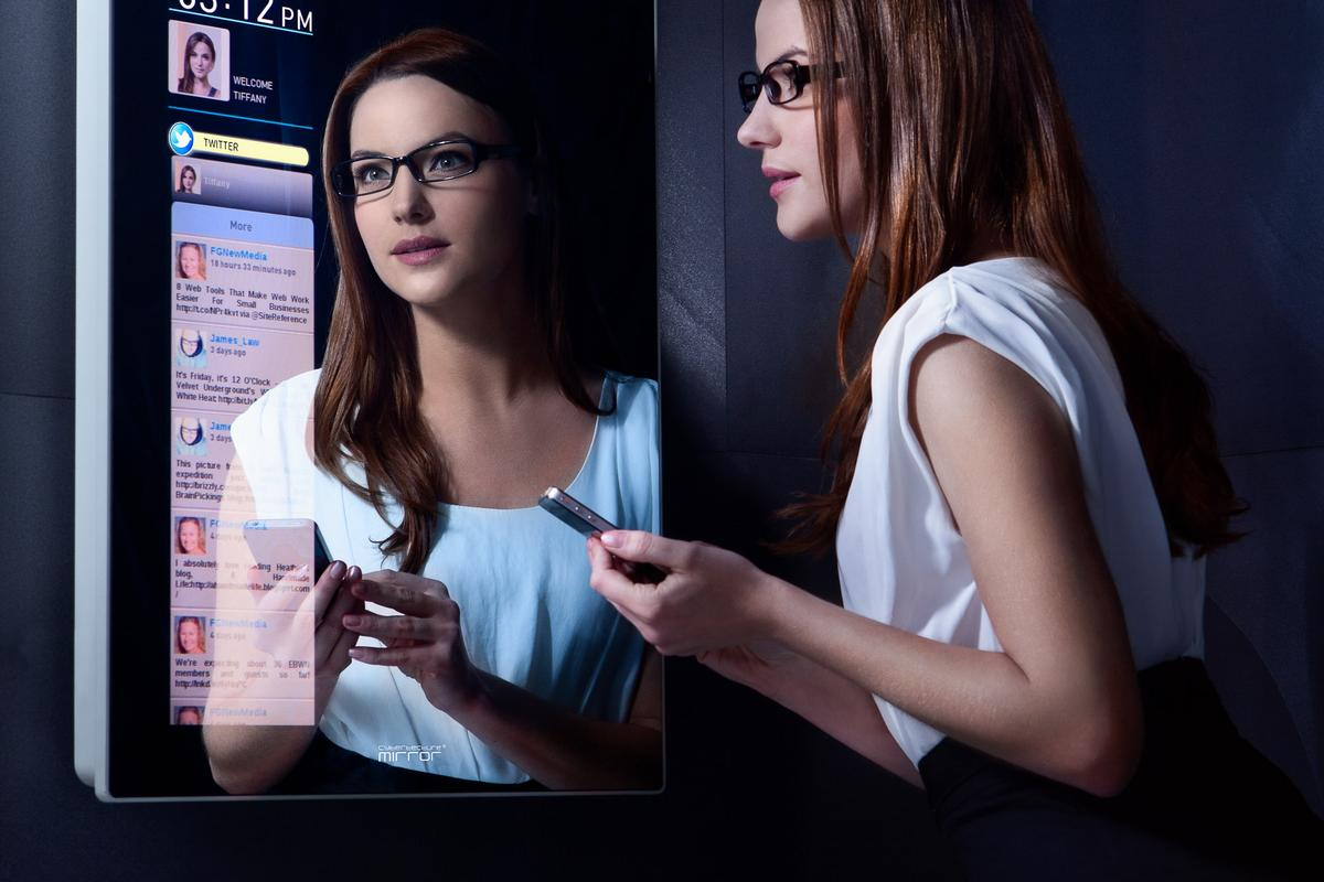 The Cybertecture Mirror presents users with a wealth of information while looking at their reflection - including weather and news, social network feeds, streamed internet TV, personal health information and can even act as a personal exercise coach
