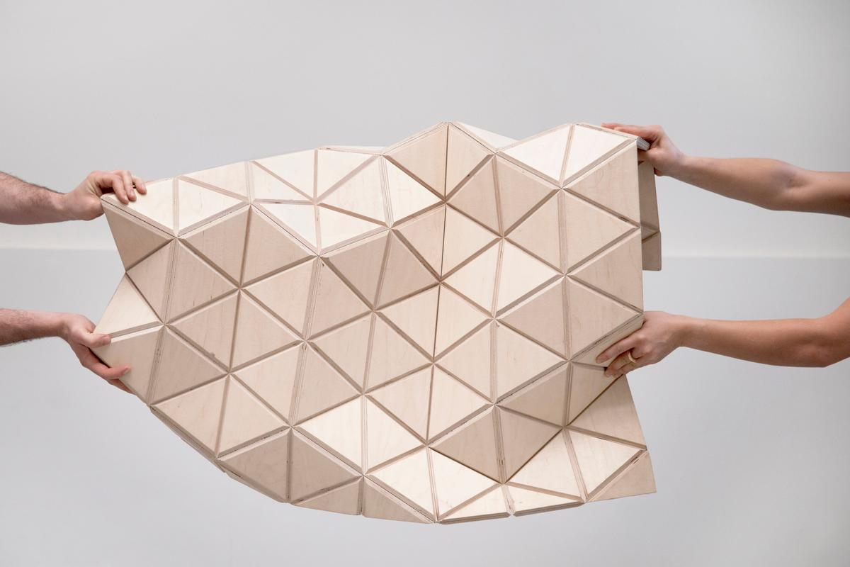 The current WoodSkin product is a sandwich of plywood triangular tiles with a textile mesh in-between (Image: MammaFotogramma)