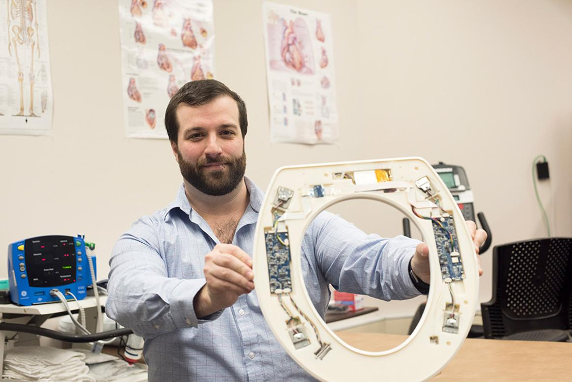 Nicholas Conn with one of the prototype toilet seats