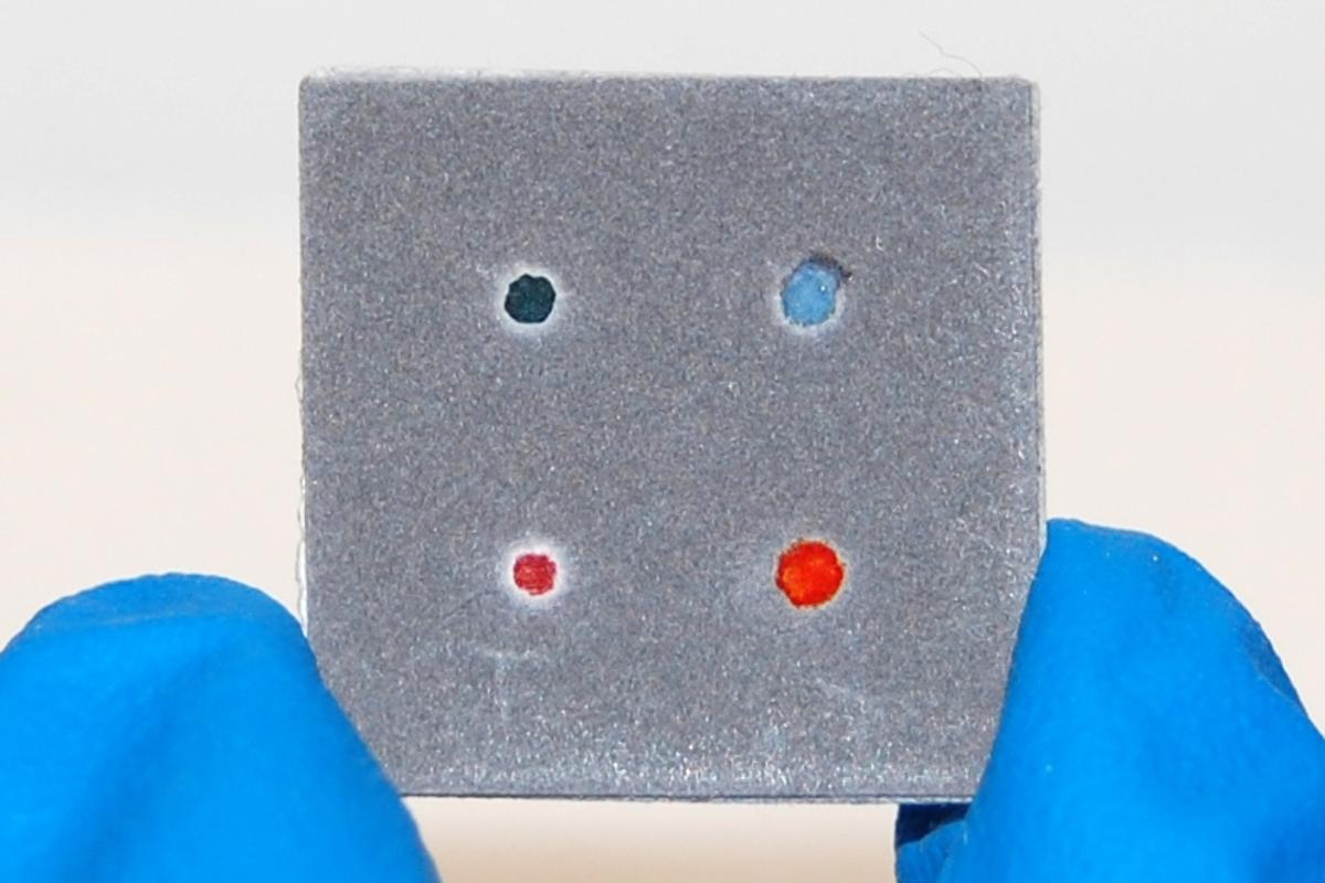 The lower right red dot indicates that this CHEMCARD paper test is ready (Photo: Scott T. Phillips)