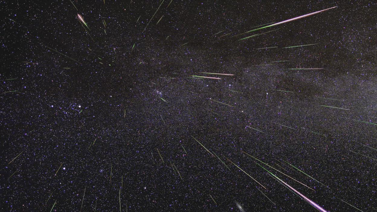An outburst of Perseid meteors lights up the sky in August 2009