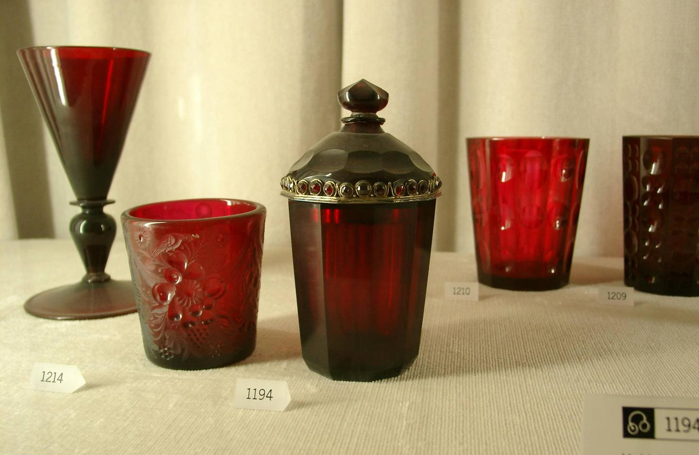 Examples of items made from gold-infused cranberry glass