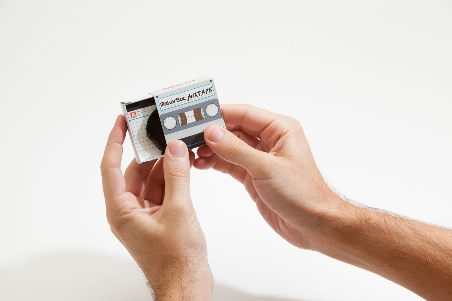 The dictaphone-like tape box contains the electronic components and the USB cable