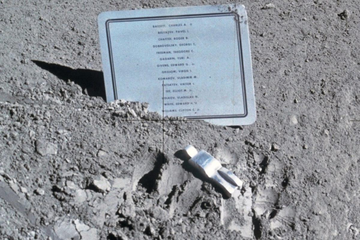 Photo of the Fallen Astronaut and accompanying name plaque left on the moon during the Apollo 15 mission