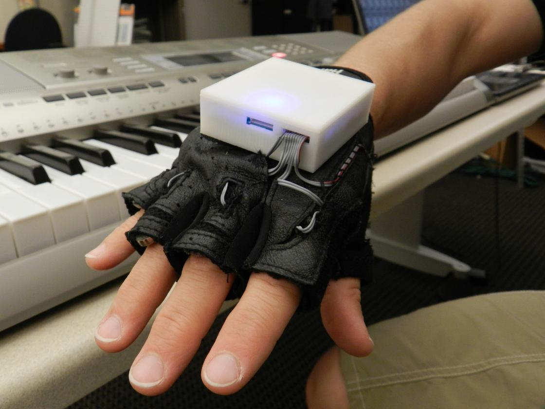 The Mobile Music Touch (MMT) system comprises a vibrating glove that connects wirelessly to a computer, MP3 player or smartphone