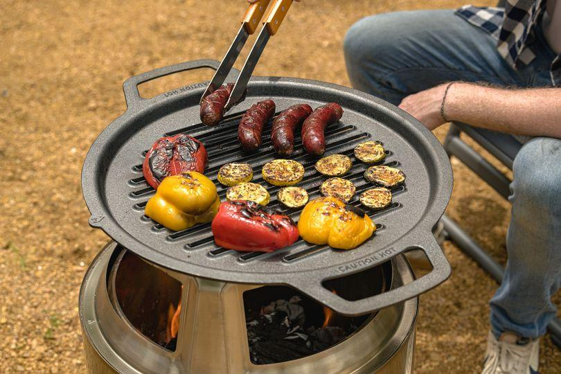 Shipping for the Solo Stove's Fire Pit Cooking system is slated for August
