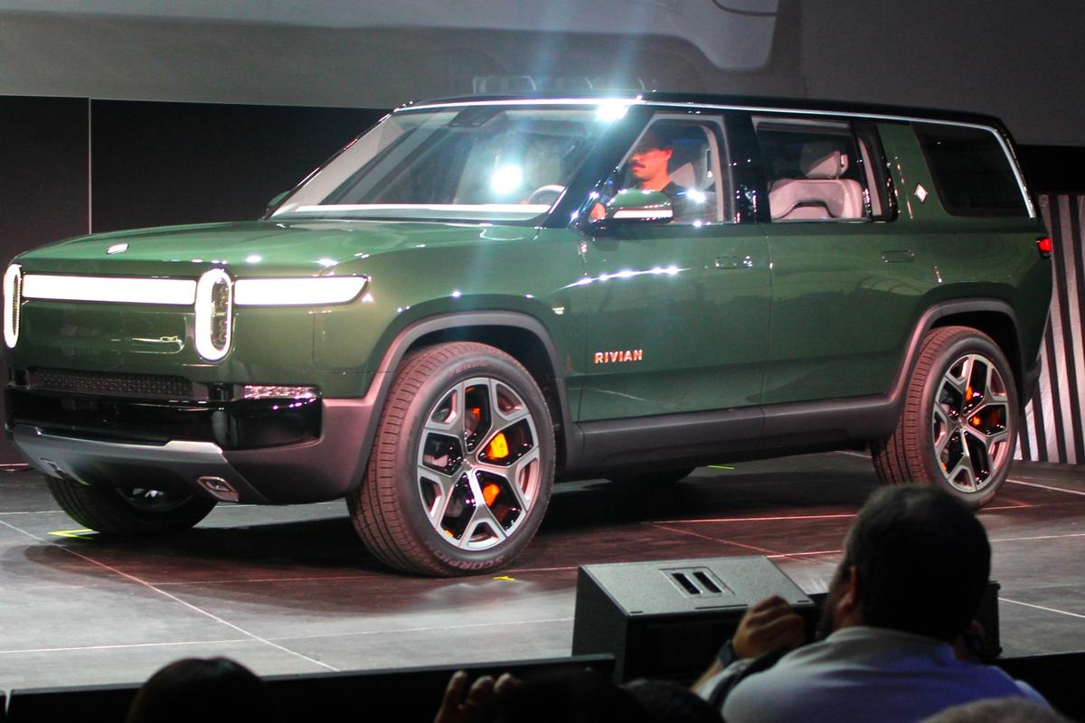 The R1S is a mixture of Land Rover and Jeep with an odd splash of Volkswagen ID conceptuals in its design