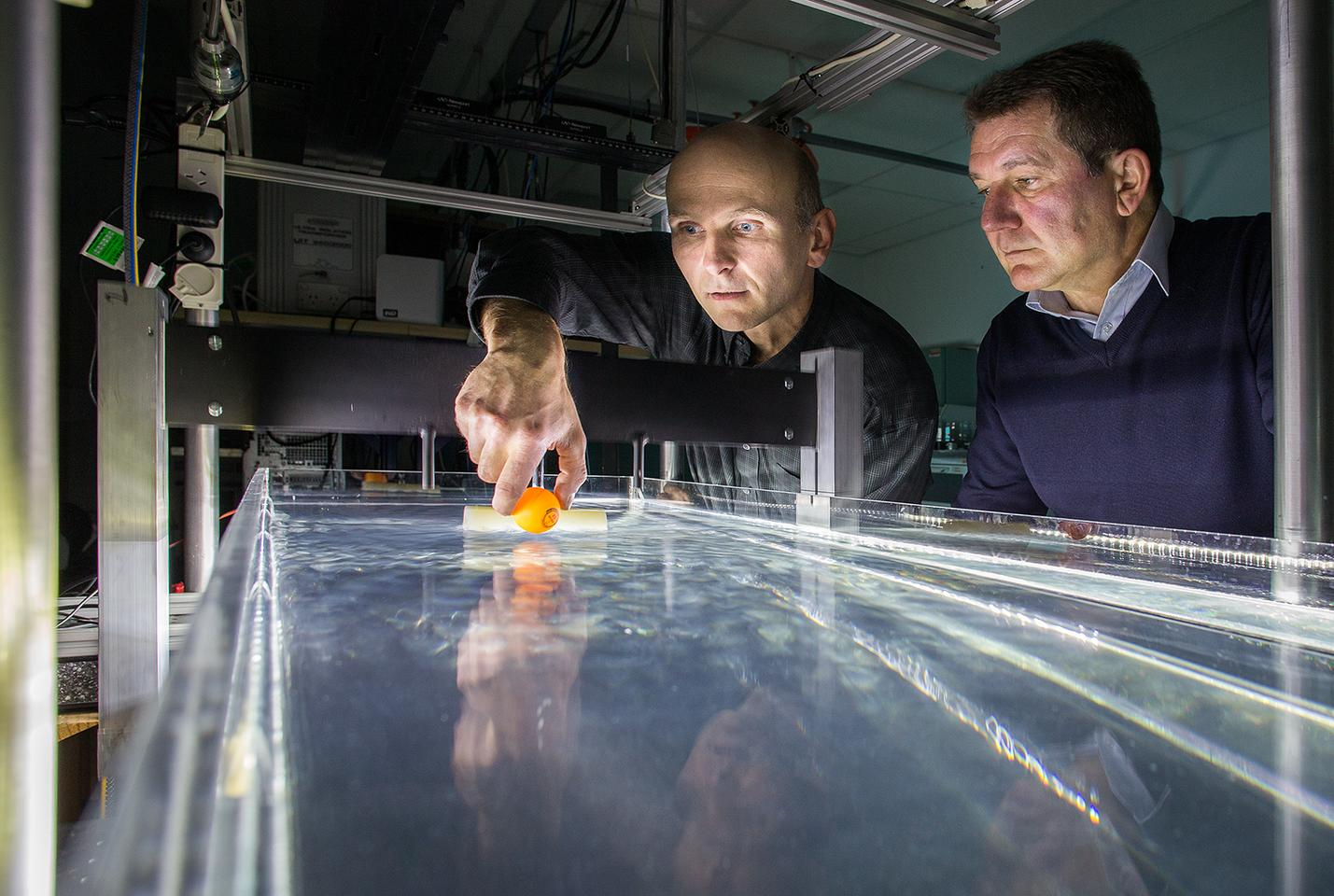 Dr. Horst Punzmann and team leader Prof. Michael Shats, at the ANU wave tank