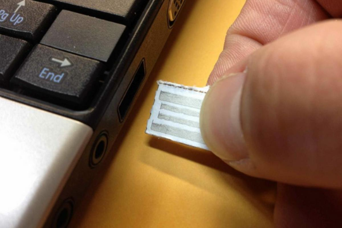With an embedded silicon chip, intelliPaper turns an ordinary strip of paper into a working USB drive