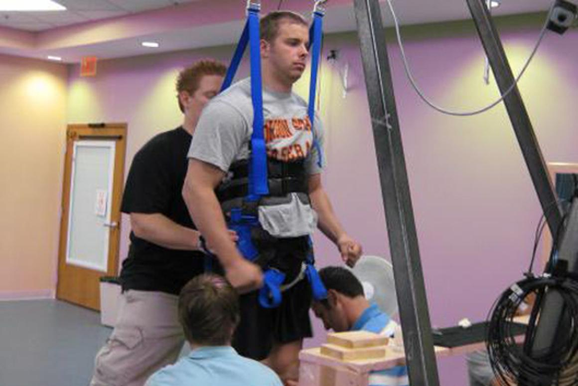 Rob Summers, 25, in the harness that provides support while he receives electrical stimulation to his spinal cord (Image: Rob Summers)