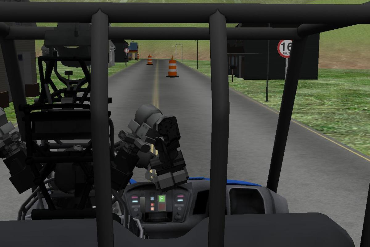 Rear view of a simulated ATLAS robot preparing to drive a utility vehicle as part of DARPA's Virtual Robotics Challenge