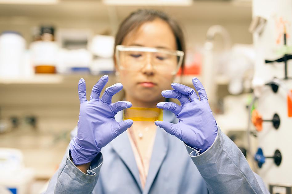 MIT postdoc, Grace Han, handles a new chemical composite that could function as a kind of thermal battery