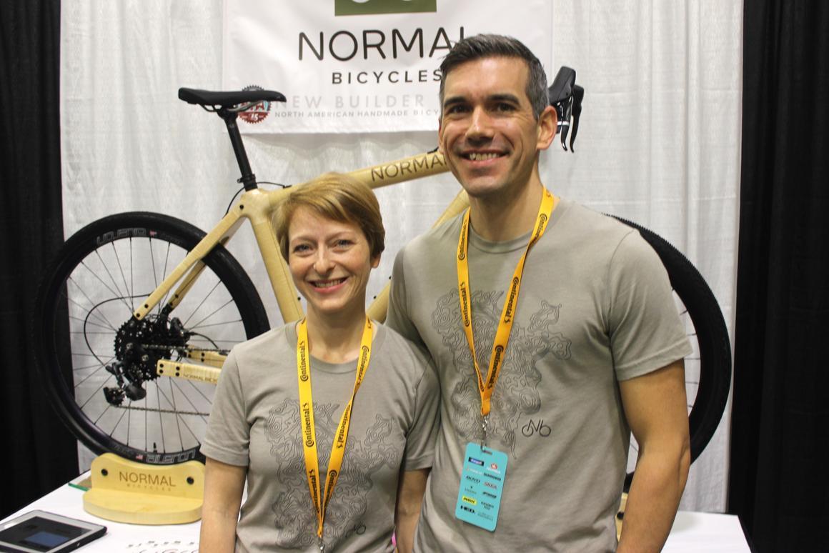 Jessica Vreeswijk Kudla and Chris Kudla, with their custom gravel bikeat NAHBS