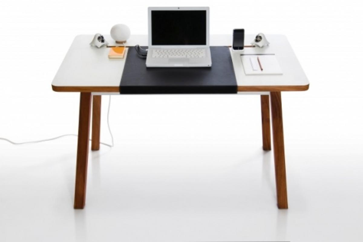 The StudioDesk might look like an ordinary table but it hides away laptop cables and other peripherals