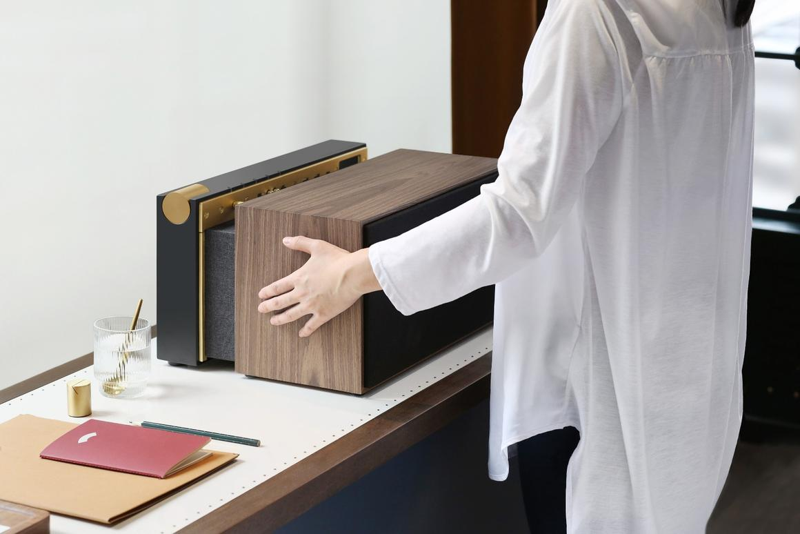 The wood veneer casing of the PR / 01 is pulled forward to reveal a hidden compartment that's home to audio and USB ports, and can stow away small gadgets