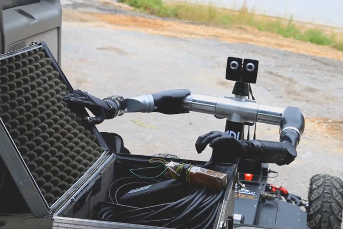 The Bimanual Dexterous Robotics Platform equipped with Modular Prosthetic Limbs (both developed at Johns Hopkins University) inspects a suspicious lock box