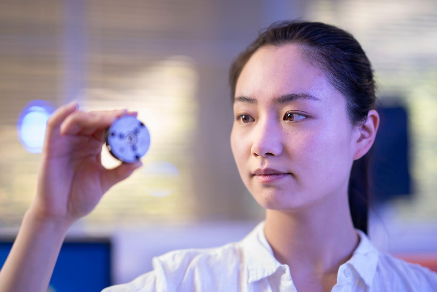 Study author Xingshuo Huang with the device used to create the lab-grown diamonds
