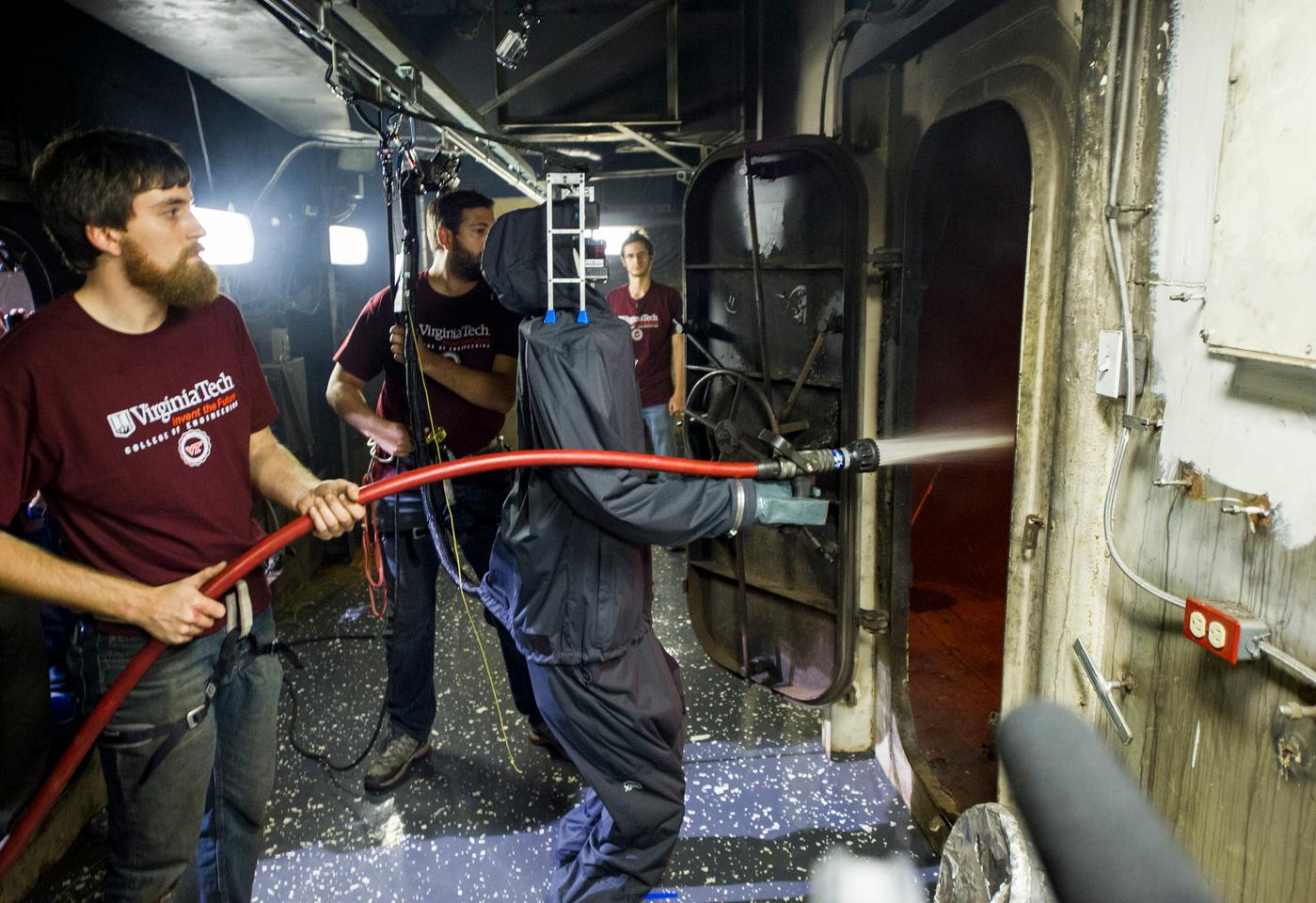 SAFFiR in a rain suit putting out a shipboard fire (Photo: US Navy)